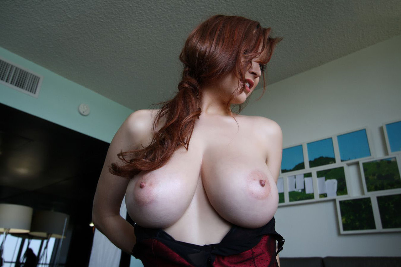 Amateur cute redhead with big natural tits